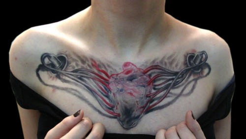 Women Chest Piece Tattoos